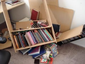 fallen bookshelf
