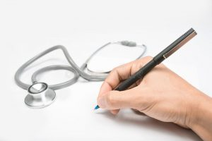 stethoscope and pen